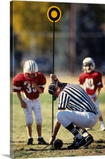 referee-measuring-for-a-first-down-during-a-pee-wee-football-game,1940937